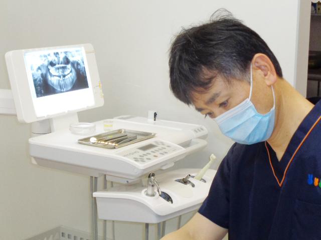 歯科医師 楠元伸久
